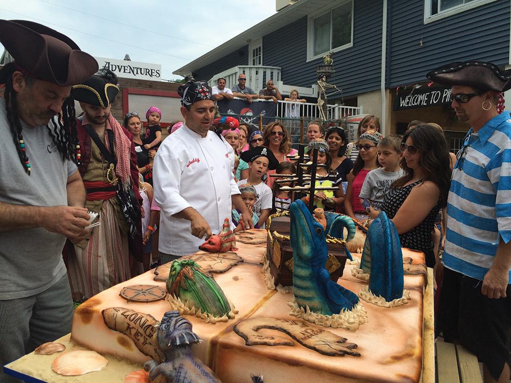 Buddy cuts the pirate cake.
